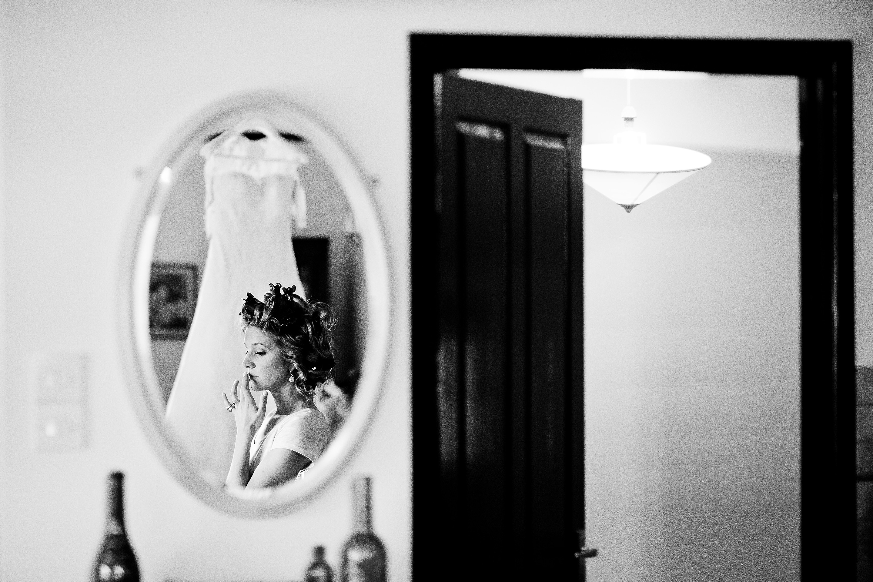 bride reflection whilst getting ready on wedding day